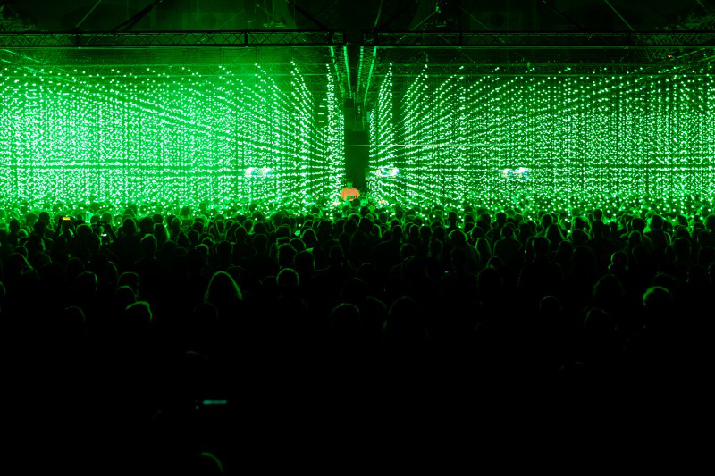 Heads at a nightclub with green lights