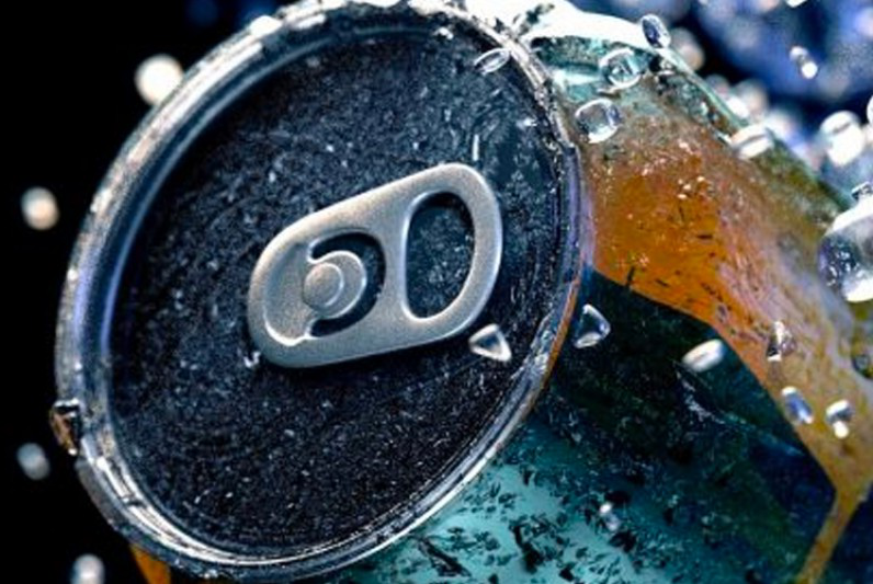 A drinks can surrounding by shattered ice