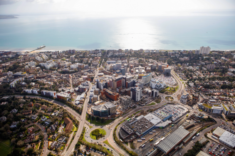 An aerial shot of Bournemouth, capturing much of the town, with the beach and sea on the horizon