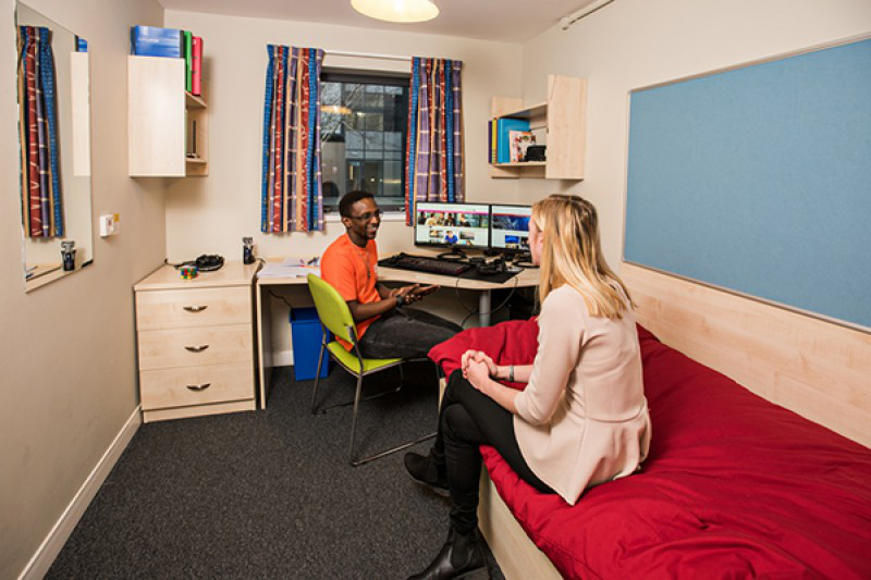 Two BU students in a hall of residence room